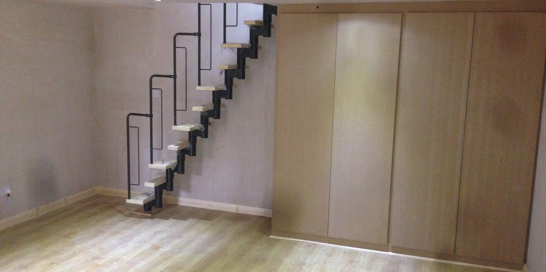 Basement room with wooden flooring