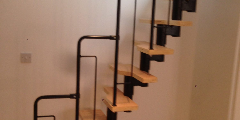 Stylish wood and metal basement steps