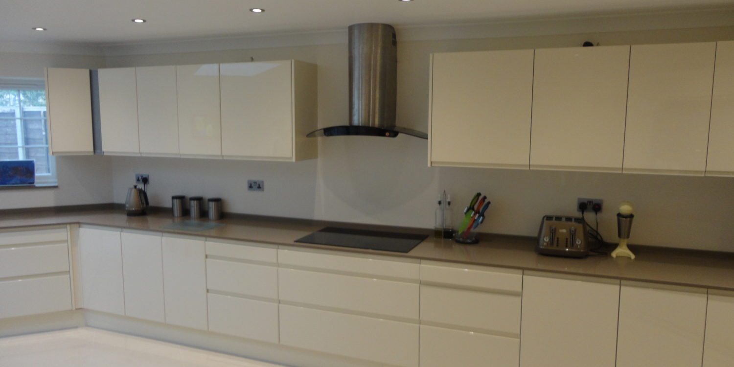 Kitchen hob, extractor and cupboards